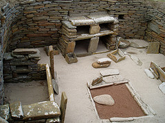 Interior of one of the dwellings at Skara Brae. Taken by Jun and shared on Flickr under a Creative Commons licence.