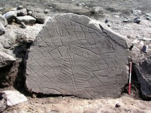 Neolithic carved stone found on Fylingdales Moor. Photo by Graham Lee, North York Moors National Park Authority.