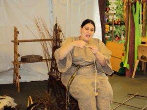 Demonstrating spinning wool