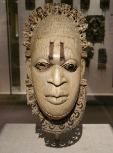 "Ivory mask of Iyoba Idia. By Wikipedia Loves Art participant ""trish"" [CC BY 2.5 (http://creativecommons.org/licenses/by/2.5)], via Wikimedia Commons"