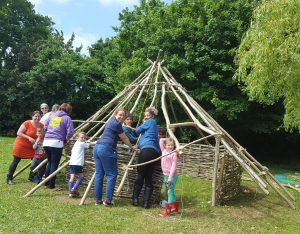 Building the skeleton of the house from coppiced materials
